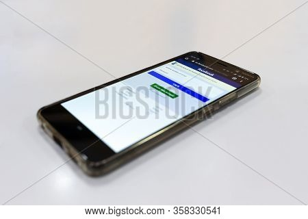 Belgrade, Serbia - February 01, 2020: Nokia Smartphone Is Shown With Facebook Social Network Log In