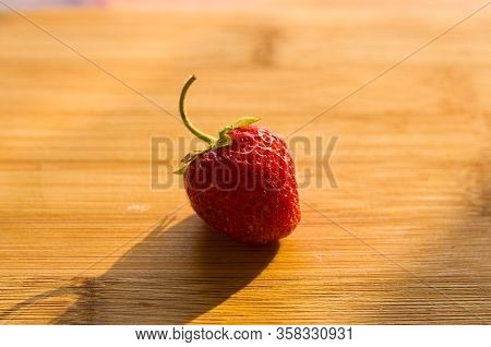Fresh Ripe Berries Strawberries On Bamboo Board, Close Up