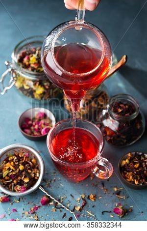 Process Brewing Tea, Tea Ceremony, Cup Of Freshly Brewed Fruit And Herbal Tea, Dark Mood.hot Water I