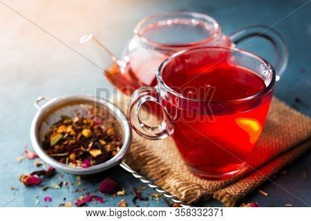 Process Brewing Tea, Tea Ceremony, Cup Of Freshly Brewed Fruit And Herbal Tea, Dark Mood.