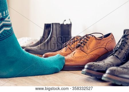 The Concept Of Choosing Mens Shoes. Brown Brogues, A Classic Shoe.