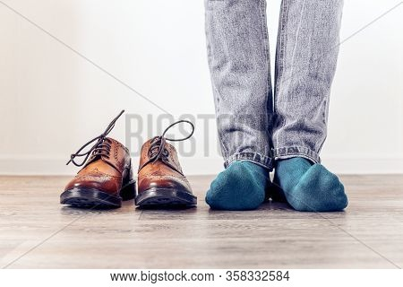 Classic Brown Mens Brogues Shoes And A Man In Blue Socks. Mens Stylish Look.