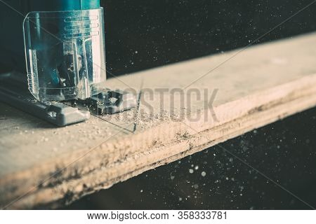 The Process Of Cutting A Wooden Board With An Electric Jigsaw