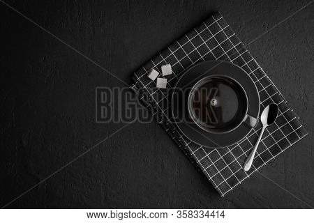 Black Coffee Cup With Sugar And Spoon On Black Concrete Table, Dark Background