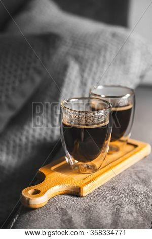 Two Cups Of Espresso On A Wooden Tray, On The Sofa In A Cozy Home Environment