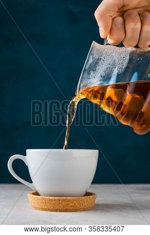 Coffee In Pour Over, Filter Coffee, A Glass Teapot In Hand .alternative Method Brewing