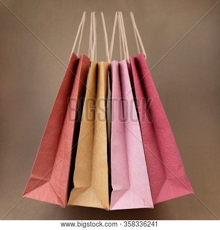 Colorful Paper Shopping Bag In Pastel Pink Colors. Conception Sale.