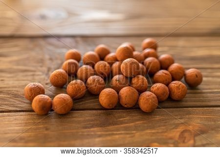 Carp Fishing. Different Of Carp Boilies And Accessories For Carp Fishing Isolated On Wooden Backgrou