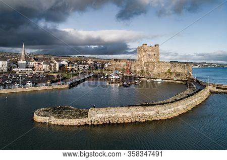 Medieval Norman Castle, Harbor With Boat Ramp And Wave Breaker In Carrickfergus Near Belfast, Northe