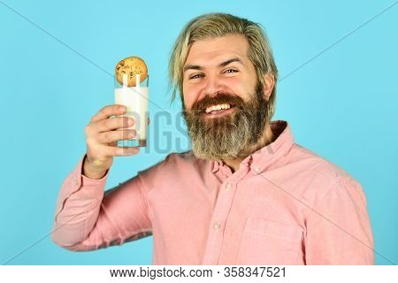 Taste Of Childhood. Bearded Man Drink Milk With Cookies. Yummy Combination. Delicious Treats. Recipe
