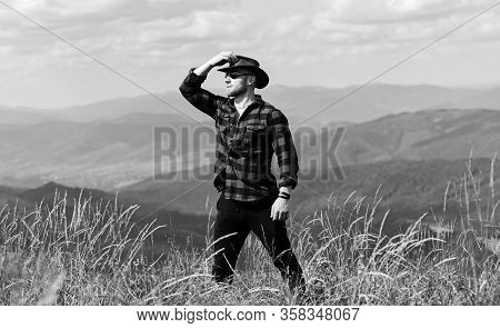 Future. Cowboy In Hat Outdoor. Man On Mountain Landscape. Camping And Hiking. Travelling Adventure.