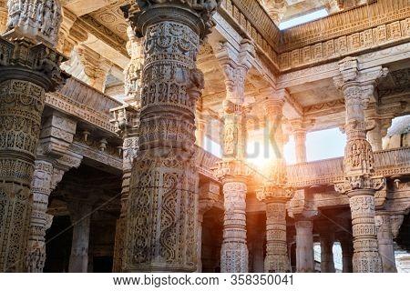 Columns pillars of beautiful Ranakpur Jain temple or Chaturmukha Dharana Vihara. Marble ancient medieval carved sculpture carvings of sacred place of jainism worship. Ranakpur, Rajasthan. India