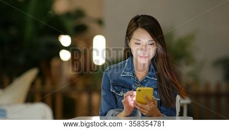 Woman use of cellphone at outdoor coffee shop