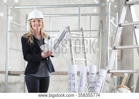 Smiling Woman Architect Or Construction Interior Designer With White Windows Cutaway Profile Inside