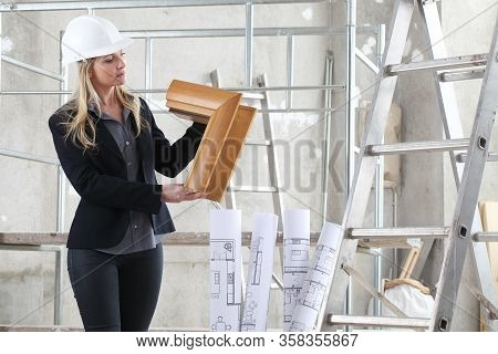 Woman Architect Or Construction Interior Designer With Wooden Windows Cutaway Inside A Building Site
