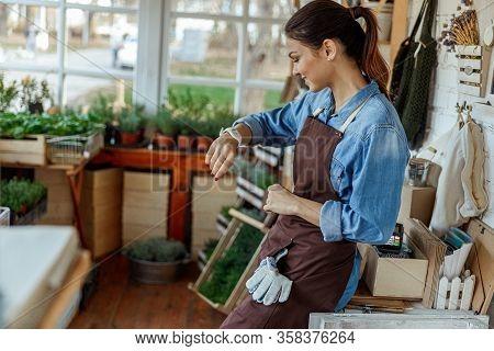 Joyful Caucasian Lady Gazing At Her Gadget