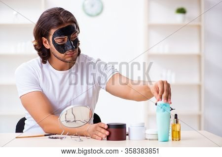 Young male cosmetician recording video for his blog
