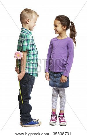 Boy Giving Pink Flower To Girl