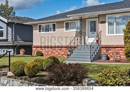 Average Single Family House With Front Yard On Land Terrace