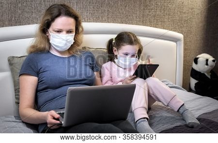 Covid-19 Coronavirus Quarantine Concept, Woman In Face Mask Working With Laptop Staying Home. Mother