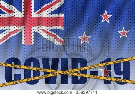 New Zealand Flag And Covid-19 Inscription With Orange Quarantine Border Tape. Coronavirus Or 2019-nc