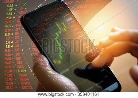 Trading Stock Graph Or Forex Online With Application On Smartphone / Businessman Trading Stocks Char