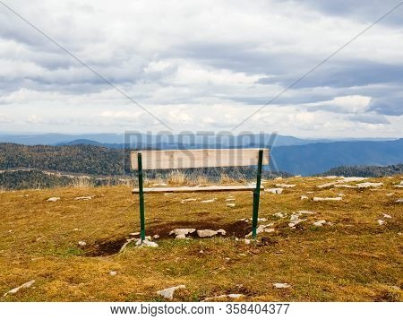 Wooden Bench In The Mountains, Copy Space. The Concept Of Solitude , Calmness, Contemplation, Medita