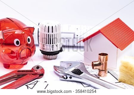 Image Shows A Red Piggy Bank With A Model House, Floorplan And Various Tools, Isolated On A White Ba