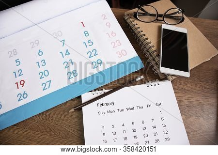 Planner And Calendar Concept.desktop Calendar 2020,diary,smartphone And Eyeglasses Place On Office D