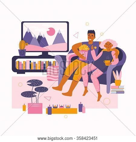 Man And A Woman Spend Time Together At Home. Young Couple Watches Movie On Tv. Home Online Movie The