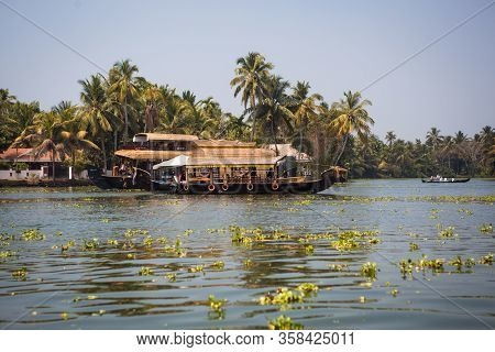 Kerala, India-February 4, 2019. A traditional tourist attraction is the house-boat on the river chan