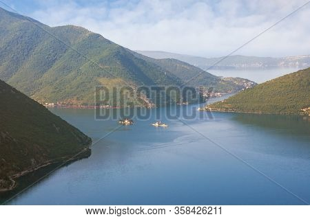 Summer Mediterranean Landscape. Montenegro, Adriatic Sea. View Of The Bay Of Kotor With Two Small Is