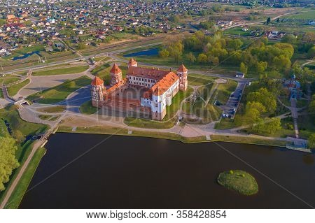 Above Mir Castle On A Sunny Spring Morning (aerial Photography). Mir, Belarus