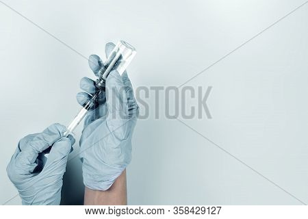 Injecting Injection Vaccine Vaccination. Nurse Preparing Coronavirus Vaccine Injection For Patient.