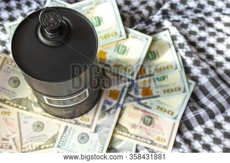 Barrel Of Oil On A Background, American Dollars And Arabian Background. Word On Barrel Is Oil. Falli