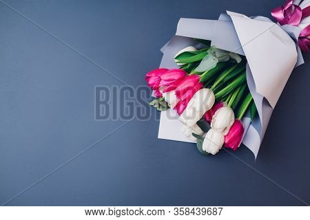 Present Gift For Mothers Day. Bouquet Of White And Pink Tulips. Womens Day Background. Spring Flower