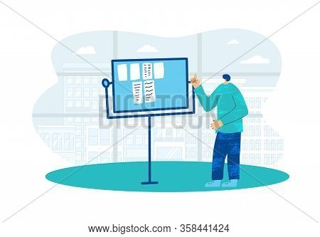 Young Man Pointing Flipchart Presentation And Explaining Diagram And Notes. Office Worker Giving A R