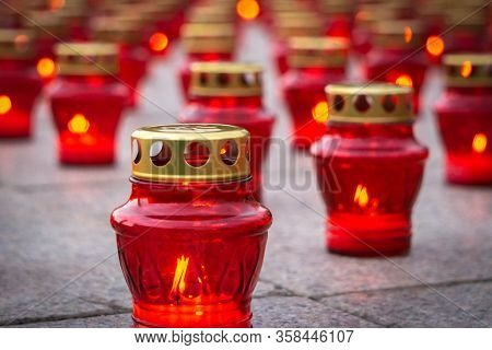 Red Lanterns With Burning Candles On Granite Slabs Background. Burning Candles In Lanterns. Rows Of
