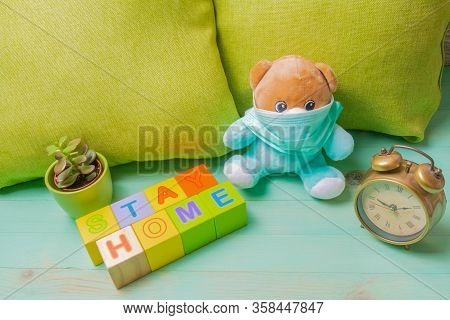 Medicine Mask On Teddy, Stay At Home Of Letters Cubes. Inscription Stay At Home And Teddy Bear With