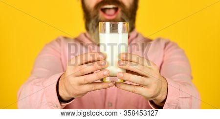Surprised Man Hold Glass Of Milk. Pasteurized Milk. Man Offer Tasty Vegan Milk From Glass. Buy In Su