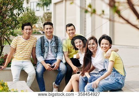 Happy Vietnamese Young People Spending Time Together Outdoors