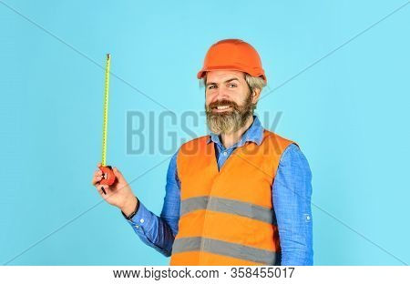 Builder With Tape Measure. Custom Made Furniture. Worker Use Tape Measure. Size Concept. Hipster In