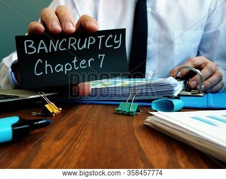Businessman Shows Sign Bankruptcy Chapter 7 Written On The Sheet.