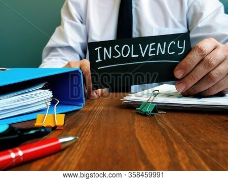Man Holds Sign Insolvency About Company Bankruptcy.