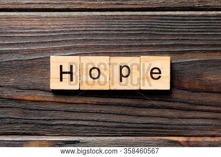 Hope Word Written On Wood Block. Hope Text On Table, Concept