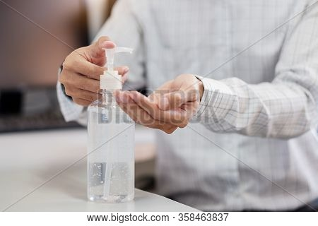 Man Hands Using Wash Hand Alcohol Gel Or Sanitizer Bottle Dispenser, Against Novel Coronavirus Or Co