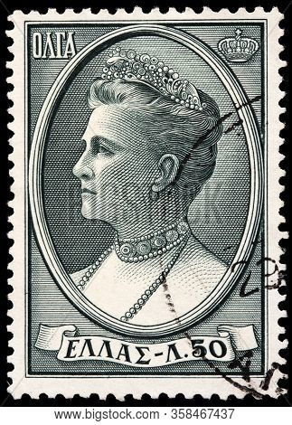 Luga, Russia - October 15, 2019: A Stamp Printed By Greece Shows Image Portrait Of Olga Constantinov