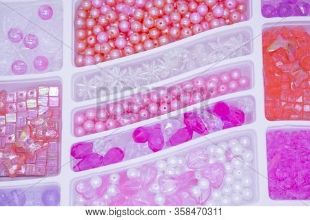 Close-up Of A Variety Of Pearls And Beads Pink, Orange, White, Violete  Colors And Transparent For C