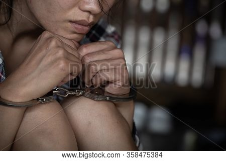 The Slave Girl Was Handcuffed And Kept. Women Violence And Abused Concept,  Human Trafficking Concep