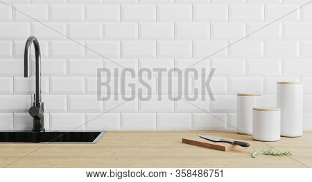 Kitchen Utensils Gadgets Near Black Sink On Wooden Surface And White Tiled Wall, Kitchenware In Kitc